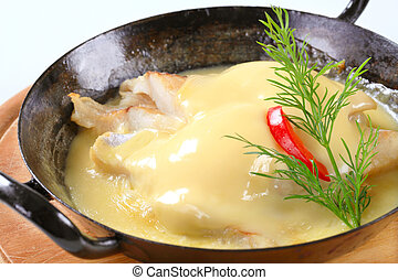 Pan seared fish with thick cheese sauce