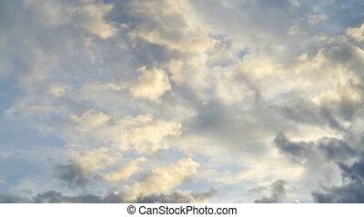 Pan shot beautiful cloudy sky with golden light
