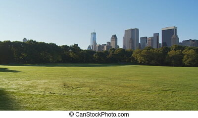 pan shot in central park over empty sheep meadow