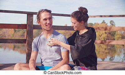 Woman massaging a man with a massage ball