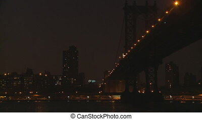 pan shot manhattan to brooklyn bridge night editorial