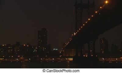 pan shot manhattan to brooklyn bridge night editorial