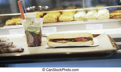 Pan shot of a sandwich on a tray in cafe