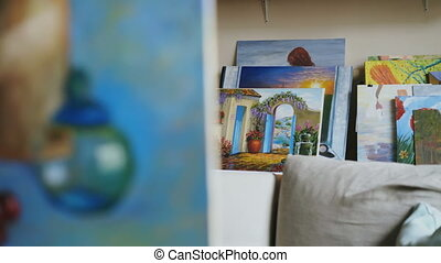 Pan shot of beautiful still life painting on canvas in art...