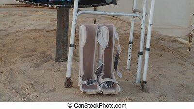 handicapped walking equipment under umbrella at the beach