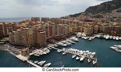 Pan shot of Monaco in spring of 2018, cars and yachts