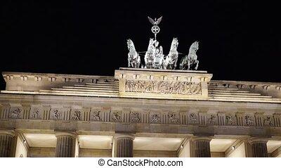 Pan shot of the Brandenburg Gate at night