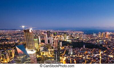 Pan shot Timelapse rooftop view of Istanbul cityscape and Golden horn at night