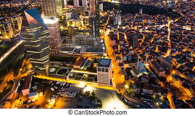 Pan shot timelapse rooftop view of Istanbul cityscape and business district at night