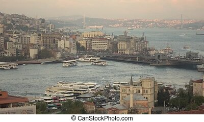 Pan timelapse view of Istanbul Golden Horn and Galata Bridge...