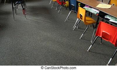 Pan up of empty elementary school classroom