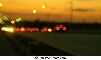 Pan Up Shot Of Freeway In The Night Lights Of defocused Cars...