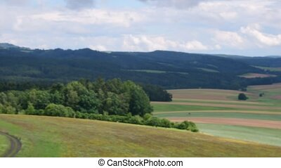 Pan view of European landscape in the summer time. Low DOF