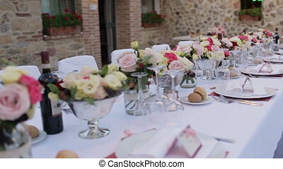Pan view of luxury restaurant table setted for wedding celebration