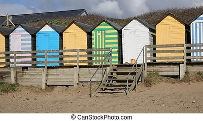 Pan view of seaside beach huts