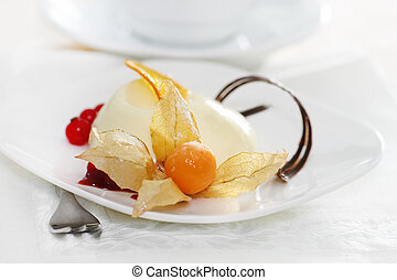 Panacotta. Classic italian dessert with red currant and...