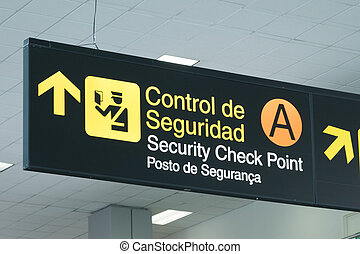 Airport information sign with security checkpoint pictogram symbol in Panama City