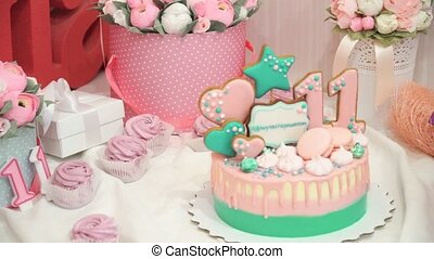 Panarama of delicious handmade pink zephyr, sweets and cake on the table with flowers in the birthday party