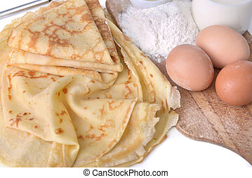 pancake and ingredient - homemade french pancake with eggs, ...