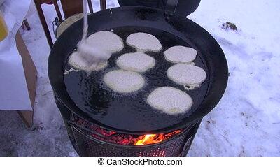 Pancake day.Mardi gras - cooking pancake in big pan on...