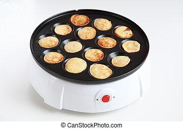 Pancake maker for mini-pancakes on white background