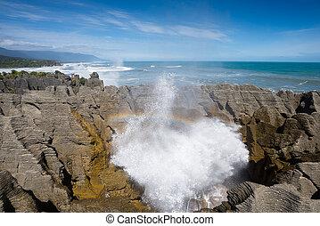 Pancake rock splash water and rainbow, Punakaiki