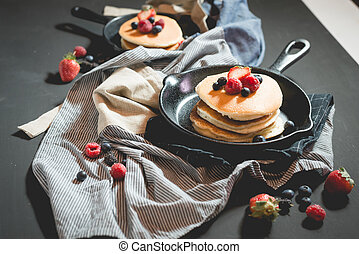 pancake with fresh fruit and berry stack on pan
