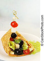 Pancake with salad
