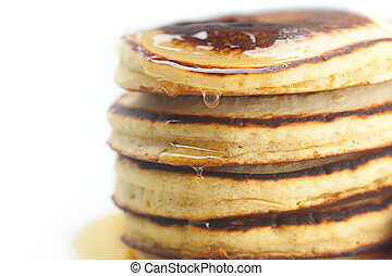 Pancakes and honey isolated on white