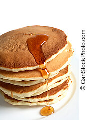 Pancakes and maple syrup - A pile of pancakes with a topping...