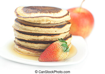 Pancakes, apple and strawberry isolated on white