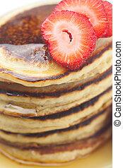 Pancakes, honey and strawberry isolated on white