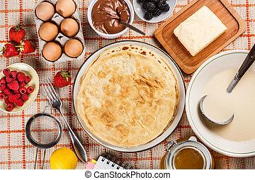 Pancakes - Ingredients for pancakes on kitchen table