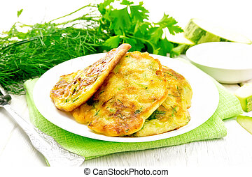 Pancakes of zucchini on towel - Zucchini fritters, dill and ...