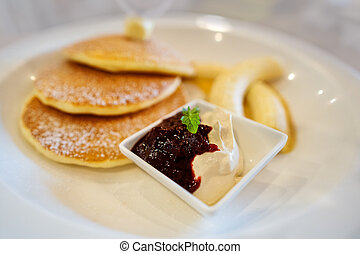 pancakes on a plate of fruit
