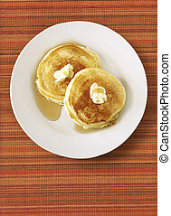 Pancakes on Placemat - Pancakes on rippled, striped orange...
