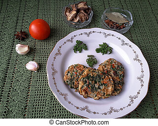 Pancakes on plate dandelion leaves vegetable fritters with...