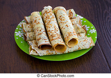 Pancakes rolls with cottage cheese on the plate. Pancakes ...