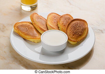 Pancakes served with sour cream