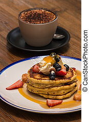 pancakes stack with cappuccino