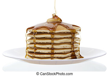 Stock image of stack of pancakes with butter and syrup over white background