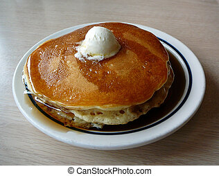 Pancakes - Stack of pancakes with butter and syrup