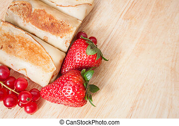 Pancakes with berries background