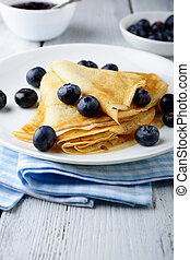 Pancakes with berries on a plate