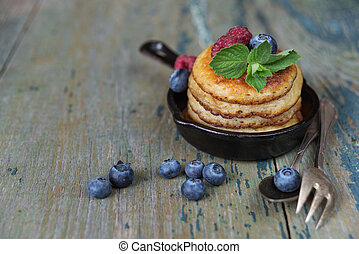 Pancakes with berries - Pancakes in cast-iron frying pan ...