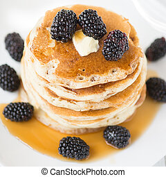 Pancakes with blackberry and maple syrup - Stack of old-...