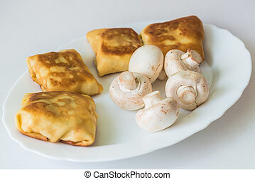 Pancakes with fillings and mushrooms on plate - Fried ...