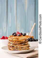 Pancakes with honey and blueberries