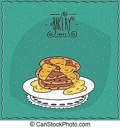 Pancakes with honey on lacy napkin