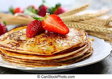 Pancakes with honey.